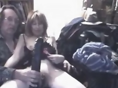 What do you think this insane older slut feels, when massive dark dildo permeates her big stretched cunt?