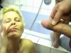 Milf acquires him off in her washroom