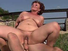 Mature bbw Manyika with shaved pussy bonking with young boyfriend at the open air