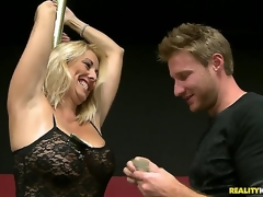 This raunchy blonde milf was showing the males the location for the charity poker tournament, and this babe used the excuse to do a little dance routine on the pole. And thats just the start...