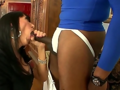 This cold bitch sucks a huge dick right in front of her filming husband, and that babe enjoys it, too. Just look at the way that babe slobbers on that thing. What a dirty little slut.