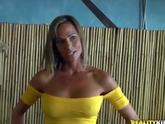 Shes a charming MILF with large fake tits and skinny figure. Leggy well stacked woman in yellow blouse and blue skin constricted jeans turns guy on. MILF Hunter can't resist! That babe is devilishly sexy