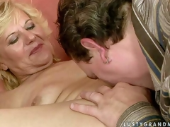 Naked mature woman Lili spreads her legs on the ottoman and get her shaggy slit fingered and licked by sexy guy. He stretches her hole with his fingers before that babe sucks his meaty sausage