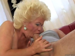 Effie is a blond-haired aged slut with fuckable titties. That babe strokes young hard dick with her nice juggs and then takes it in her mouth. That babe shows her hairy mature cum-hole while doing it