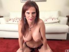 Sexy Jennifer Darksome caresses her big fake tits