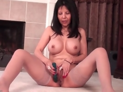 Mommy with big round tits bonks a sex-toy