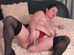 Plump mature in nylons and panties masturbates
