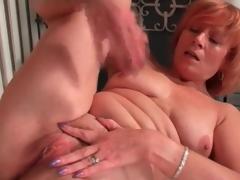 Mature redhead rubs her clitoris in masturbation porn