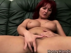 Dirty redhead MILF with giant boobs goes sexually excited on the couch