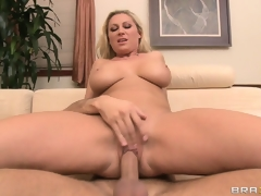 Jumping on top, the charming blond rides her neighbor's dick with enthusiasm