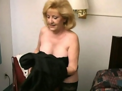 Lustful blonde grandma Kitty Fox stripping and showing her hawt decolletage