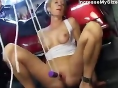 Mature wench sucks him in garage